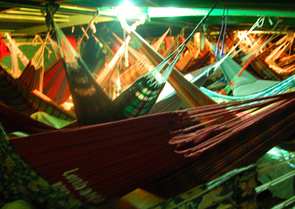 Hammocks on large lancha at night. Photo by Campbell Plowden/Center for Amazon Community Ecology